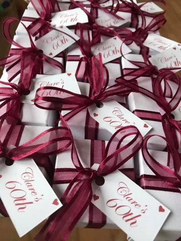 White Boxes with Burgundy Ribbon and a personalised tag to celebrate Clare's 60th Birthday