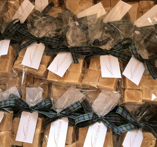 Corporate gift bags of Scottish Tablet with tartan ribbon and a swing tag with corporate logo and message